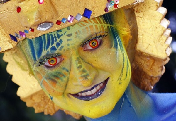 A participant poses with her body painti