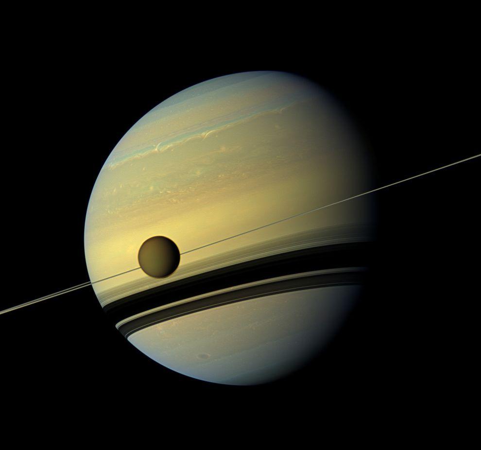 Titan floating slowly along the orbit of Saturn