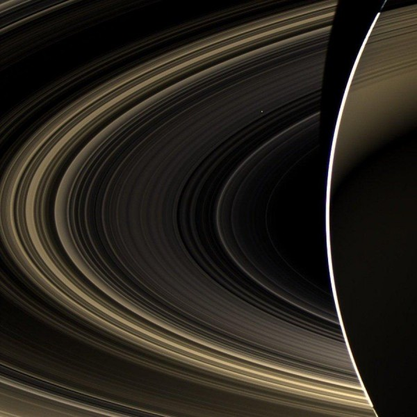 Rings of Saturn and a barely noticeable through them Venus