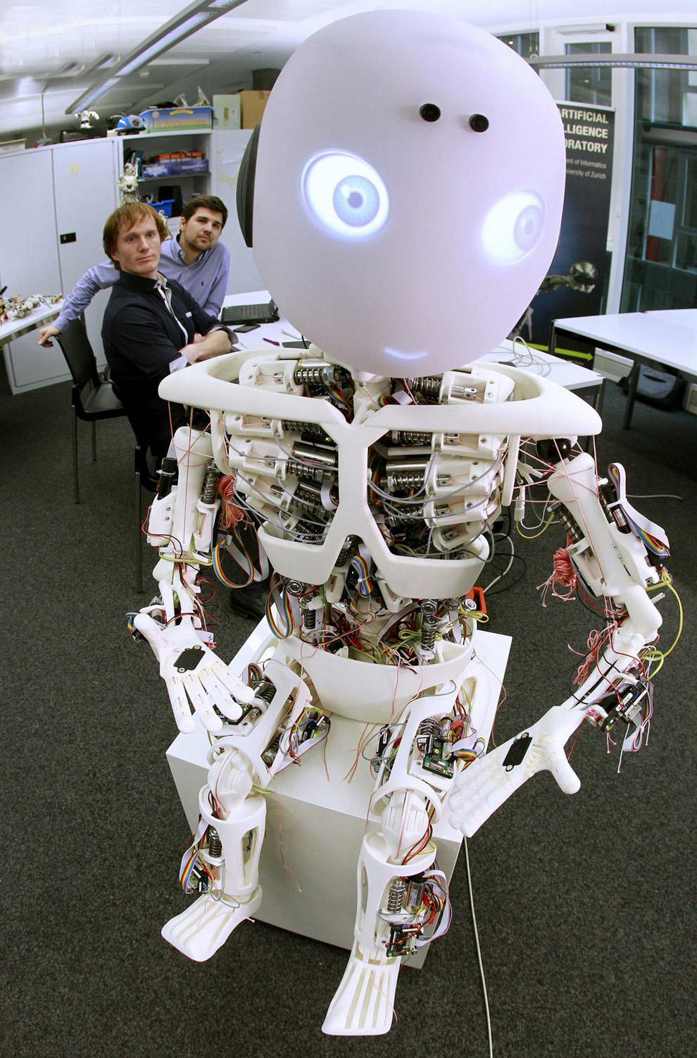 Engineers Dominik Brumm and Serge Weydert, gives commands to the robot