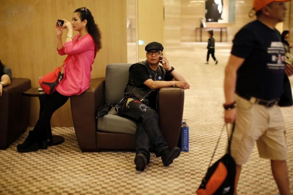 Biker on the phone at the hotel during the annual Harley Davidson rally at Lake Qiandaohu in Zhejiang Province, China