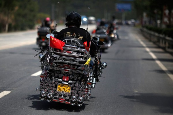 Biker rides a Harley Davidson motorcycle during the annual rally