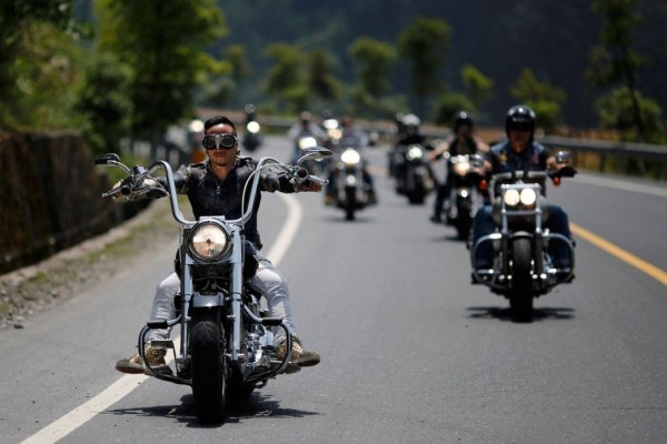 Bikers take part in the annual Harley Davidson rally at Lake Qiandaohu in Zhejiang Province, China