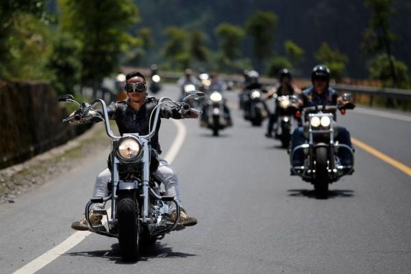 Bikers take part in the annual Harley Davidson rally at Lake Qiandaohu in Zhejiang Province, China