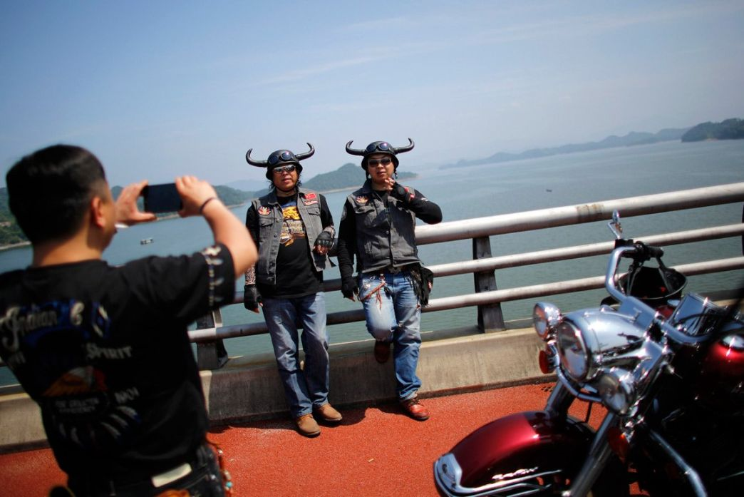 Bikers pose for photographers during the annual Harley Davidson rally