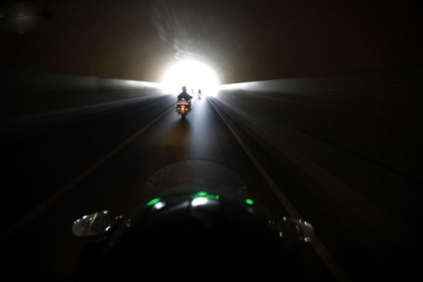 Bikers ride through the tunnel during the annual Harley Davidson rally