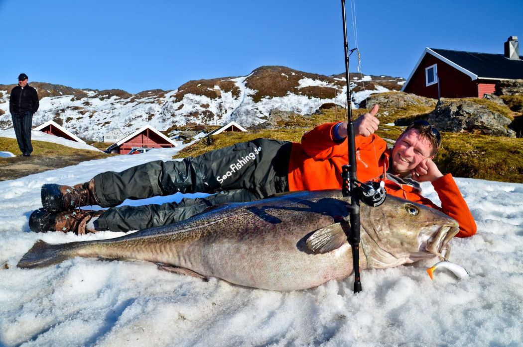Michael Eisele poses with cod caught them in Norway