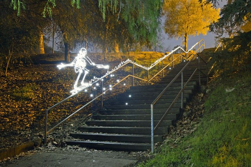 A light image of the skeleton, sliding down the banisters