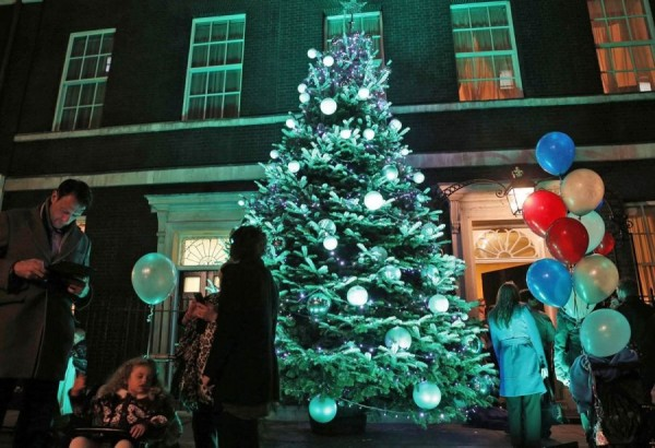 Britons going near the Christmas tree in London at Downing Street, 10. December 9 tree at the office of the Prime Minister lit up with colorful lights