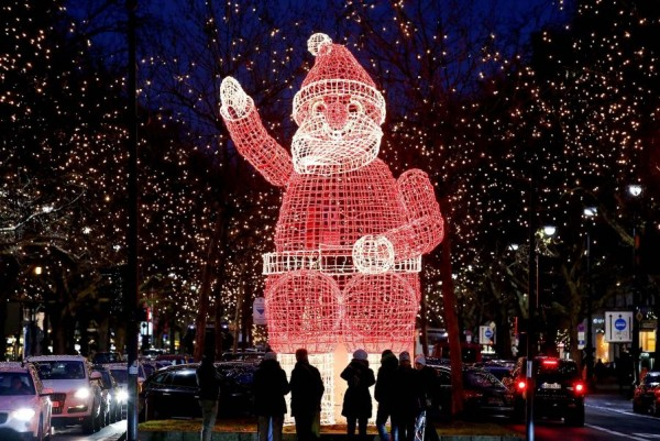 Massive luminous figure of Santa Claus in Berlin, Germany