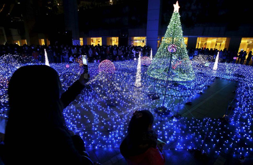 People take festive illumination in Tokyo, Japan