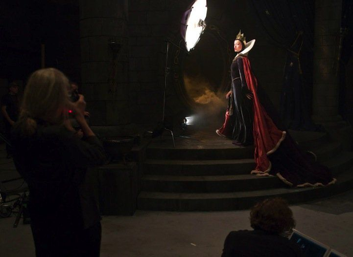 Olivia Wilde as the Evil Queen and Alec Baldwin as a magic mirror