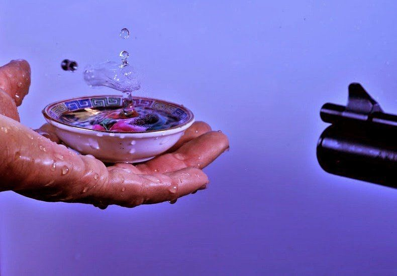 High Speed Photos of Bullets through Water Drops