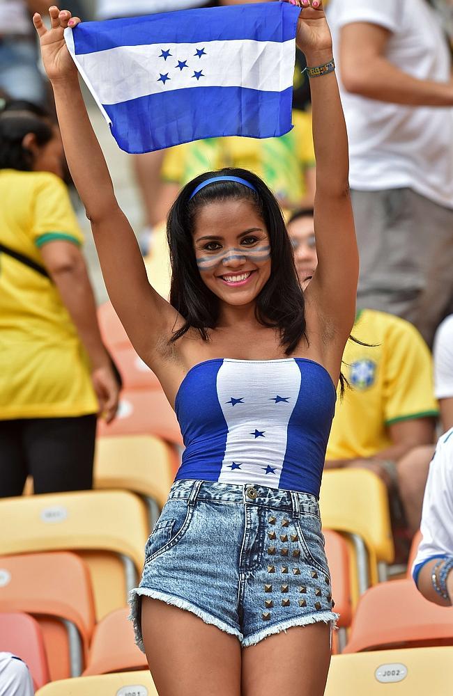 A Honduras fan cheers for her team