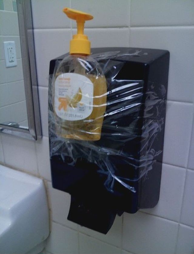 The janitor too lazy to open the dispenser