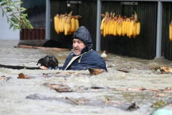 This Man Saving His Dog From The Floods