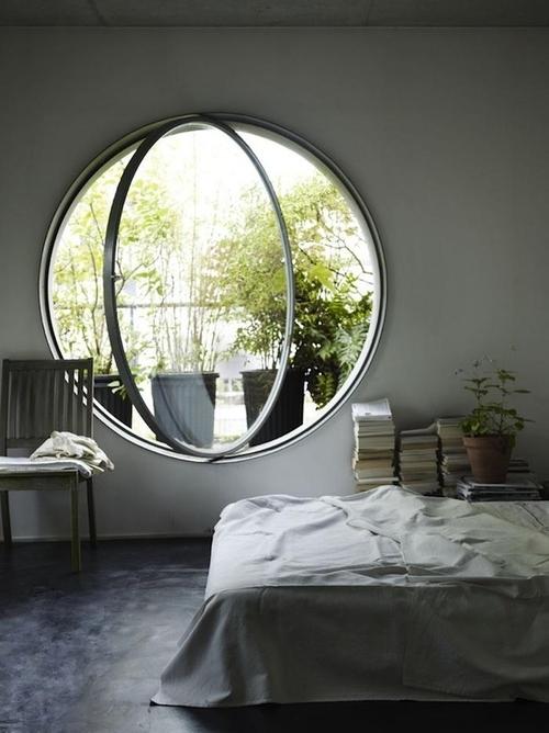 A Huge Round Bedroom Window