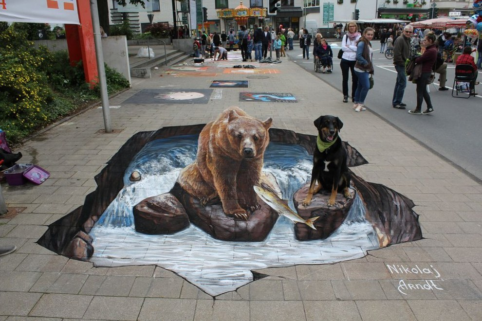 A grizzly and a dog, hanging by the river.