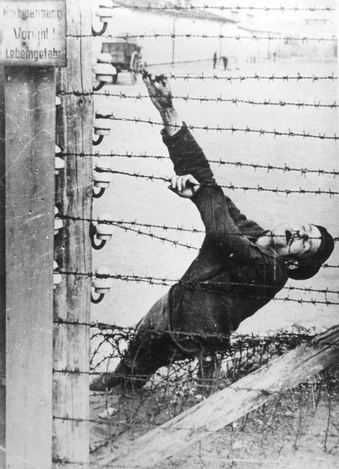 Auschwitz, Poland, 1943. An inmate who committed suicide on the electrified fence.