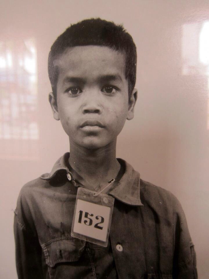 Cambodia s22 genocide victim. They pined the letter trhough the neck. He is one of 1.5 million citizens tagged, documented, and excuted by the Khmer Rouge for the crime of 'being educated'