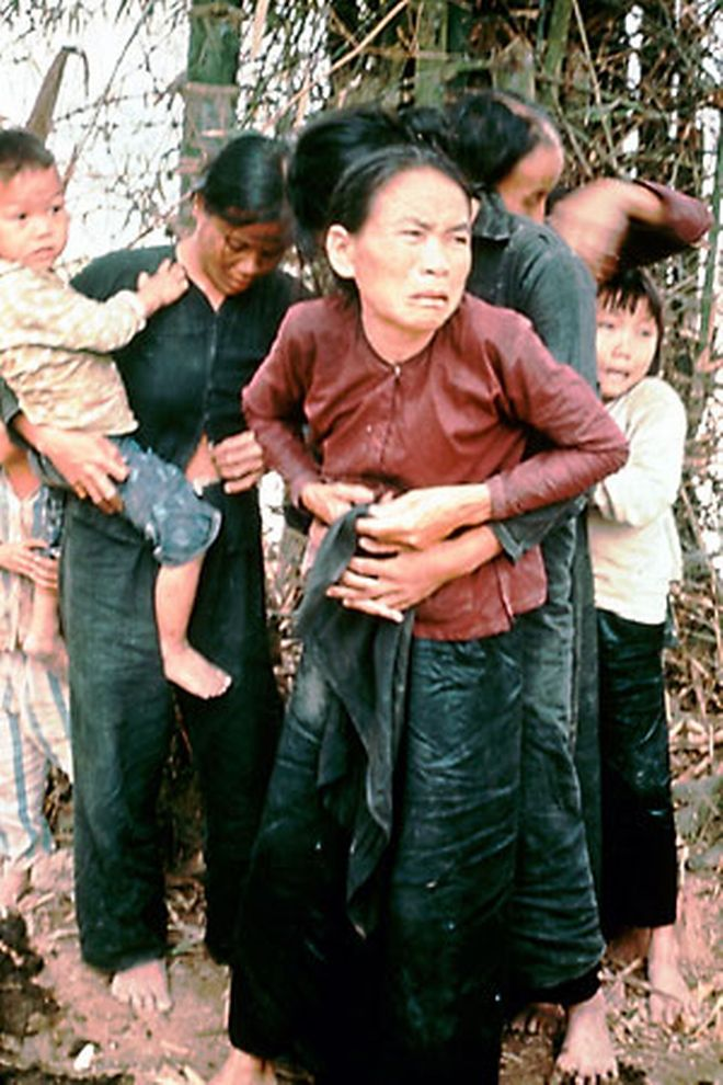 Vietnamese villagers, including children, huddle in terror moments before being killed by American troops at My Lai, Vietnam, March 16, 1968.