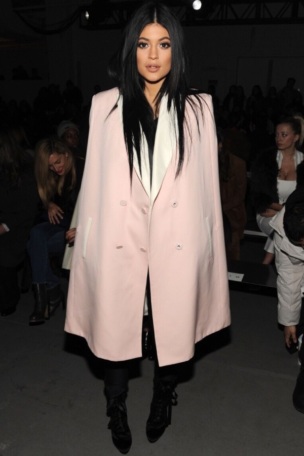 Kylie Jenner in coat during fashion show